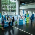 Bupa's wellbeing expo just opens with work colleagues approaching for health consultations